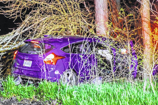 Driver transported to Upper Valley Medical Center after striking tree.