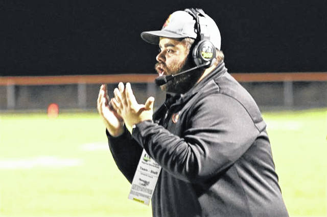 New Tri-County North Panthers football coach, Adam Hall calls a defensive play for the Ansonia Tigers in the OHSAA 2018 playoffs.
