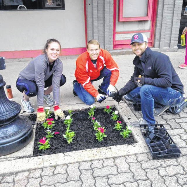 Provided photo Volunteers will plant flowers at more than 70 locations throughout the downtown district during Main Street Greenville's Planting Day.