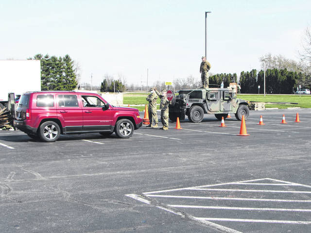 Ohio National Guard and Reserve members handled the food distribution of the Shared Harvest products late Wednesday afternoon and evening during a drive-thru at the Ansonia Local School parking lot. Ten cars at a time were allowed on the lot with the distribution handled in a timely manner.