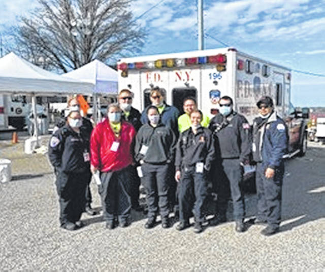 A group from Spirit are shown during their deployment to New York where they are helping out medics and firefighters on the streets of New York. Shown are, front row from left, Julie Case, Wanda Schroeder, Amanda Fellers, a member of NYFD; and back row, Tony Beyke, Brian Brown, Cole Grillot, Josh Didier, Tyler Pratt, and another member of NYFD.