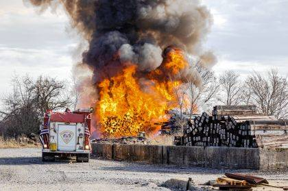 Firefighters from multiple department worked to put out a railroad ties fire.
