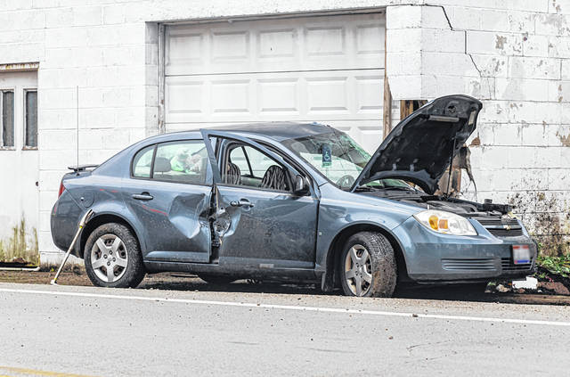 A woman suffered minor injuries after crashing her vehicle in Coletown Thursday morning.