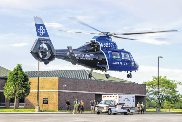 CareFlight lifts off from Bradford High School, transporting a child who suffered burns to his upper extremities Monday evening.