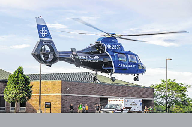 A young child was airlifted for severe burns after falling into a fire pit.