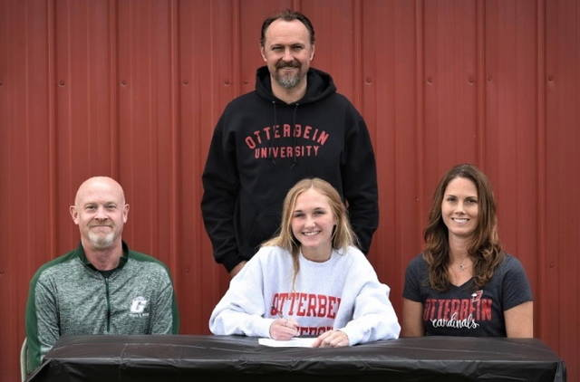 Greenville's Emma Klosterman signs with Otterbein University track and field program. (Front L-R) Bill Plessinger (GHS track & field coach), Klosterman and Shelly Klosterman (mother). (Back) Rob Klosterman (father).
