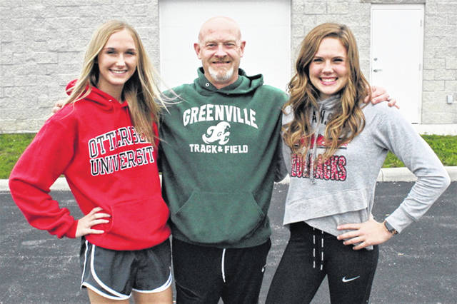 Lady Wave track and field record holders, (L-R) Emma Klosterman, GHS track and field coach Bill Plessinger and Riley Hunt.