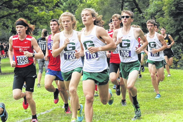 Green Wave cross country runners compete in the 2019 Treaty City Relays in the Greenville city park.