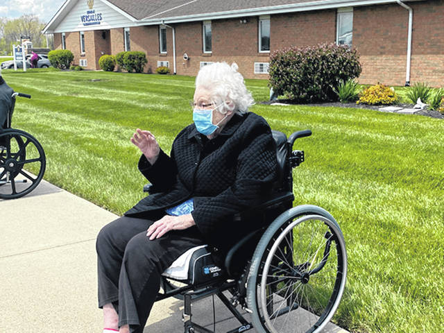 Provided photo Versailles long-term care resident, Esther Schafer enjoys a car parade by the Versailles Rehabilitation and Healthcare Center held on Sunday, May 10, in honor of Mother's Day and Skilled Nursing Care Week at the care center.