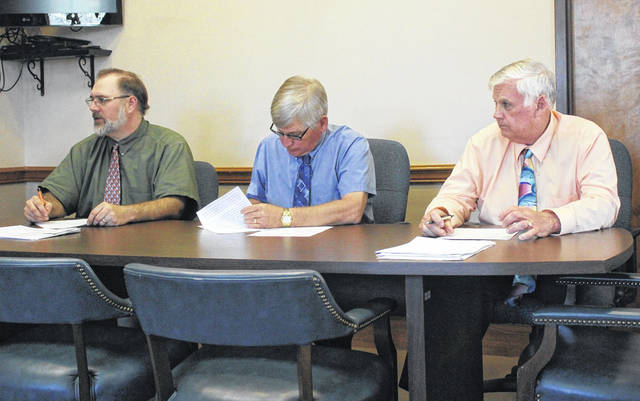 Darke County Commissioners Matt Aultman, Mike Rhoades and Mike Stegall signed a letter Monday requesting that Ohio Gov. Mike DeWine allow businesses in the county to reopen.
