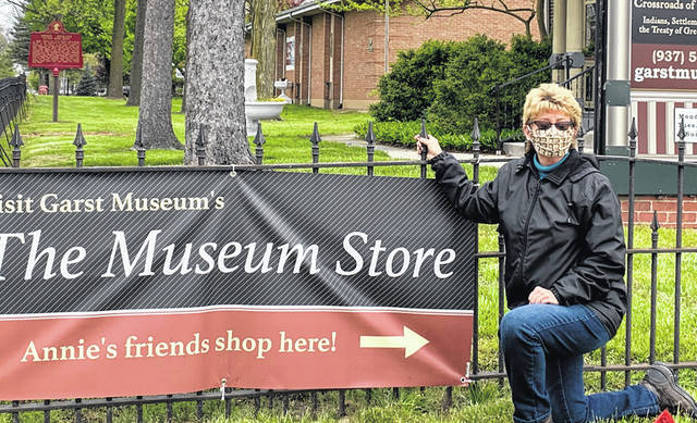 Sharre Grubb models the unique Annie Oakley mask outside the Garst Museum.