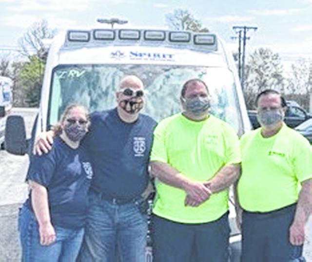 Among those Spirit Medical Transport, LLC, employees traveling to New Jersey for two weeks to serve were, from left to right, EMT Angela Weidner, Captain/Paramedic Charles Rock, Captain/Advanced EMT Todd Marburger, and Paramedic Mike Woodford.