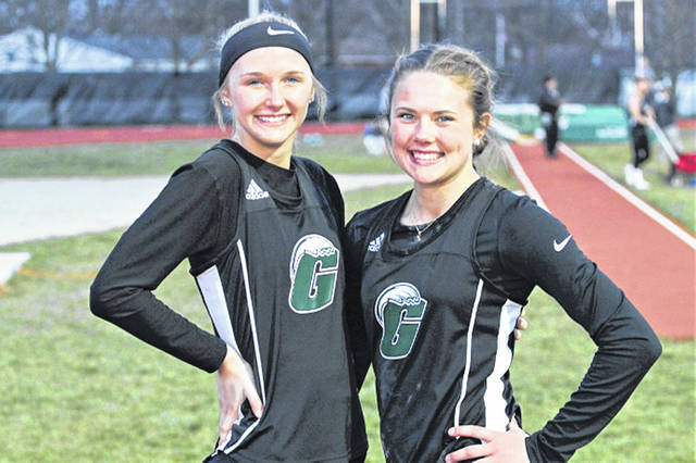 Emma Klosterman (long jump) and Riley Hunt (pole vault) set new varsity track and field records for the Lady Wave at the 2018 Salzman Relays.