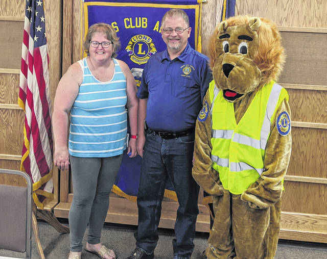 The Union City Lions Club installed officers during its May 26 meeting. Shown are Diane Dubeansky, Lion Jim Dubeansky, and the new Lions Club mascot (worn by Amanda Enicks).