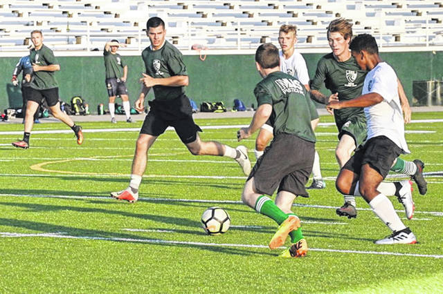 Greenville alumni and 2019 varsity soccer players showcase the incoming 2019 boys team at the annual Greenville Alumni Soccer Games.