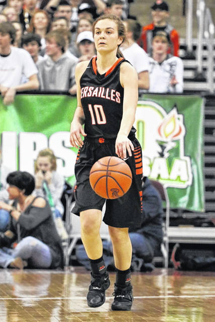 Kami McEldowney brings the ball upcourt for the Versailles Lady Tigers in the OHSAA State Championship basketball game.