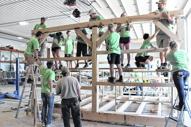 Matt Light (top right) helps build timber frame building at the 2019 Light Foundation Timber Frame Leadership Camp.
