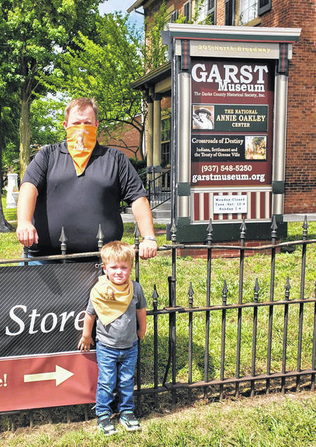 """Aaron Kruckeberg and son, Leads, sport Annie """"bandAnnies"""" at the grounds of the Garst Museum in Greenville."""