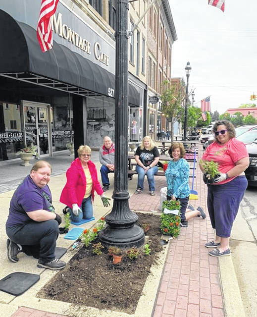 Members of the former Darke County Democratic Women's Club decided to continue planting the box they have had for many years, one of many groups sprucing up downtown Greenville.