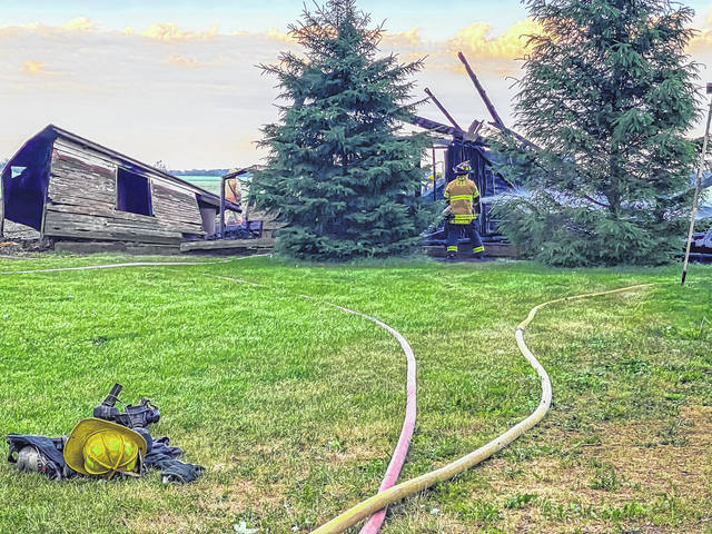 Multiple firefighters arrived to fight a fully engulfed barn at Dull and Albright Roads near Arcanum Wednesday. The cause of the fire has not yet been determined.