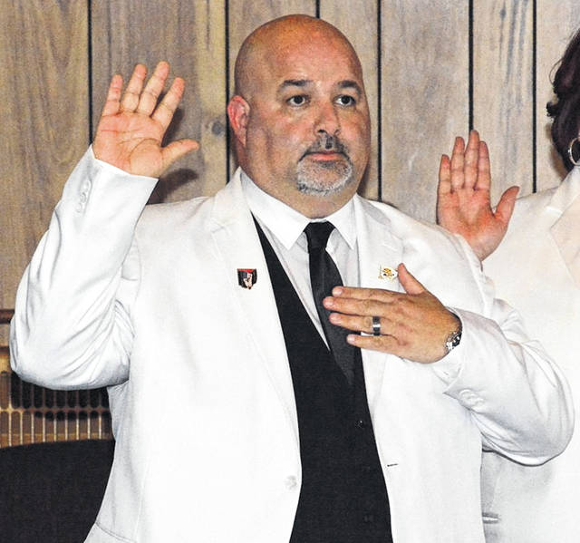 James Sigler takes part in his swearing-in ceremony as president of the Indiana Elks Lodge.