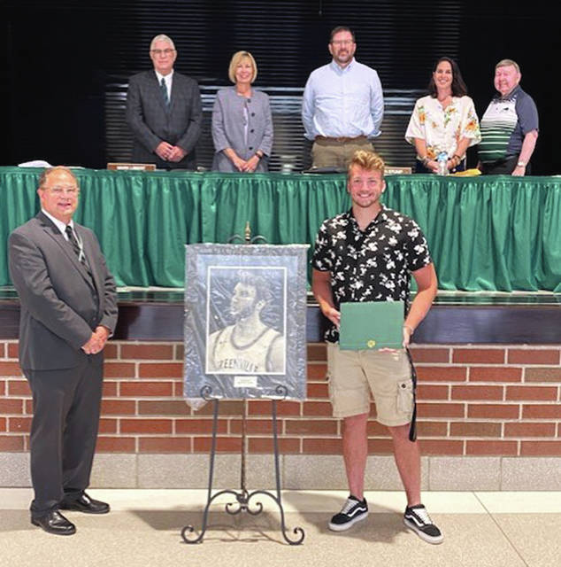 Foster Cole received the Greenville City Schools Board of Education Art Award for 2020 at Thursday's Board of Education meeting. In front are Greenville City Schools Superintendent Doug Fries and Cole. Standing (left to right) are board members Mark Libert, Krista Stump, Brad Gettinger, Missy Riethman, and Jim Sommer.
