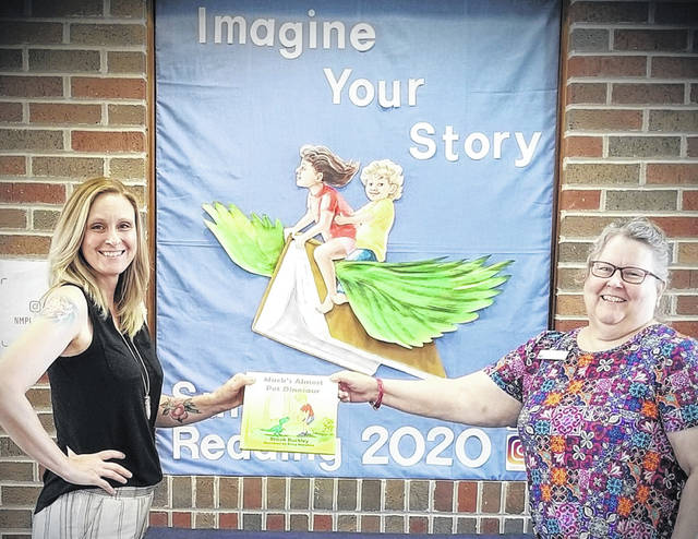 """Brook Buckley, left, is shown with Brenda Miller of the New Madison Public Library. """"I feel it is fitting because without Brenda and the library I may have never accomplished my goal,"""" Buckley said."""