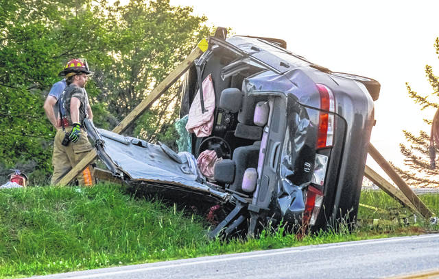 Rescue personnel responded to the scene of a rollover crash Thursday evening near Arcanum.