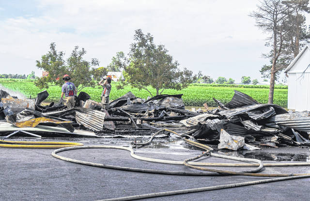 Fire fighters from multiple agencies responded to a barn fire near Laura Wednesday afternoon. The structure was a total loss, with nearby buildings damaged from the heat.