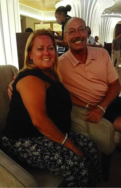 Tina and John Davis have much to smile about, thanks to help of the Rayburg family.