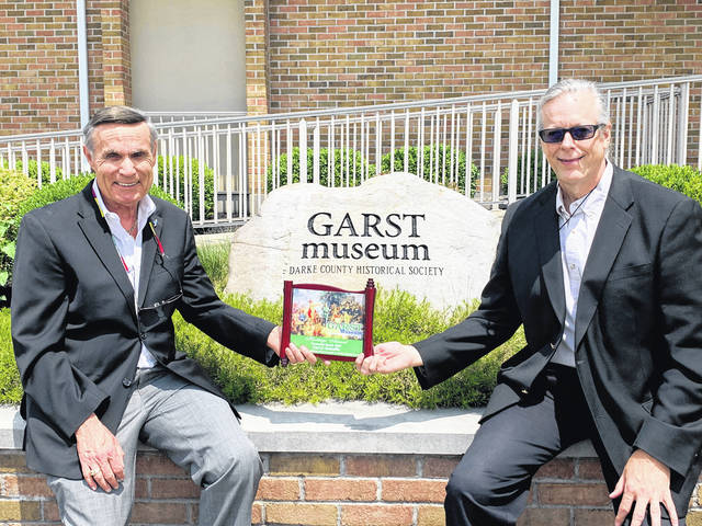 Darryl Mehaffie (left) receives the Heritage Award from Dr. Clay Johnson at the Garst Museum.