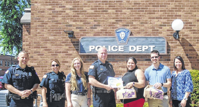 "Greenville City Police personnel accepted their donated lunch from Randall Insurance Agency employees Tuesday morning via the insurance company's new project, ""Thank You Taco Tuesday."" Shown, from left to right, are Sgt. Doug Flannery, Officer Jennifer Freeman, Dispatcher Taylor Hoover, Lt. Scot Ross as well as Misty and Benjamin Randall and Jodi Cates."