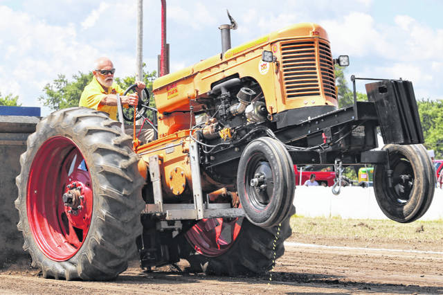 An antique Minneapolis-Moline pulls for distance at the Darke County Tractor Pullers Association's first pull of the season.