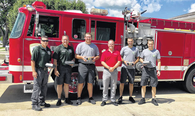 Poeppelman (red shirt) donated Buffalo Wild Wings to every shift at the Greenville Fire Department.