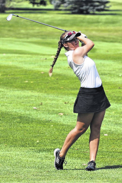 Greenville's Kenna Jenkinson makes a shot for the Lady Wave varsity golf team.