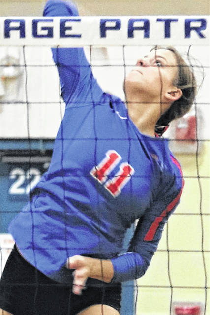 Maria Petry goes to the Lady Patriots' net for a kill in Tri-Village win over Dixie.