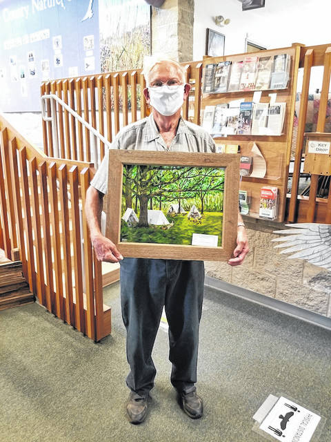 "Alan Fourman won the painting ""Under the Oaks,"" from a Garst Museum fund raiser."