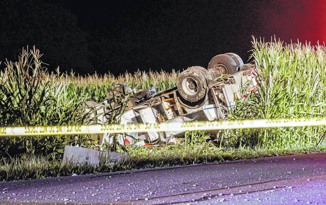 An Arcanum man was pronounced dead following the rollover crash of his utility truck Saturday night.