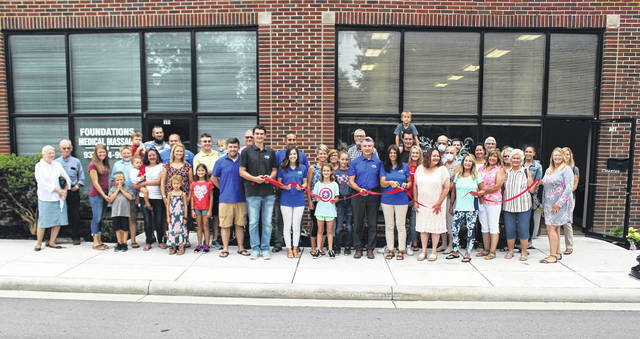 The Wise family, accompanied by friends and extended family, opened Lasting Legacy Memorials this past weekend at 114 N. Broadway.