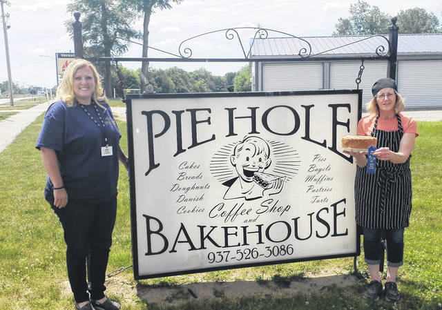 Accepting the first prize blue ribbon for The Pie Hole Bakehouse was owner and baker, Cathy Yant (right).