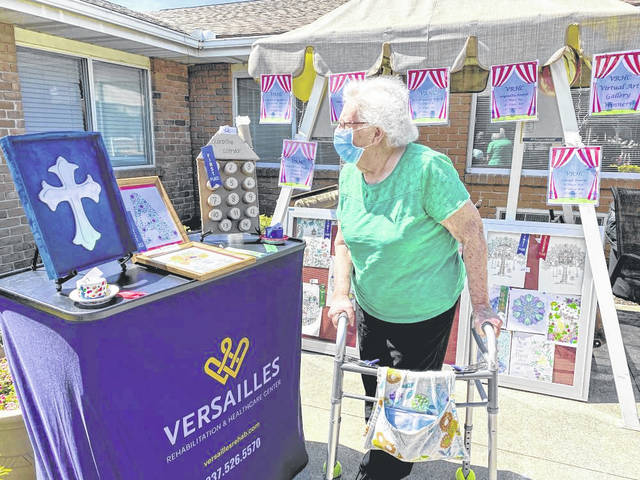 Resident, Virginia Smith, viewing art display