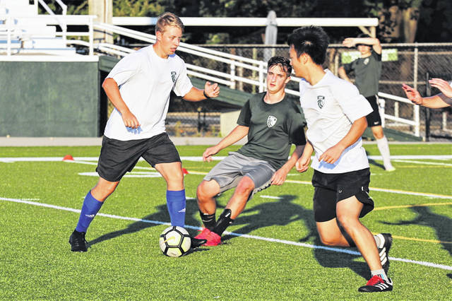 Wave Green battle Greenville white at Tuesday night varsity soccer practice.