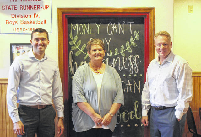 Congressman Warren Davidson (right) came to New Madison last Tuesday to visit local businesses and see how the town spent its grant money. He is shown along side New Madison Mayor, Monyca Schlechty (middle), and his District Manager, Ben Thaeler (left).