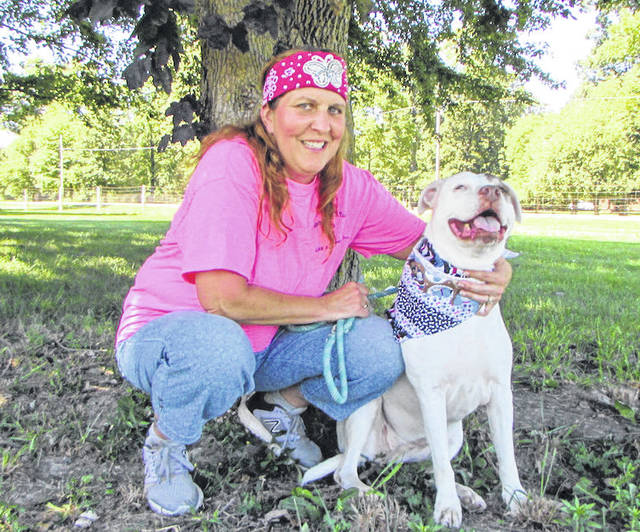 Carla Hill-Clark, founder of BARK Animal Rescue, and her lovable pit bull, Miss Petey.