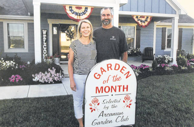 Kristie and Bill Garber, winners of the Arcanum Garden Club's July Garden of the Month award.