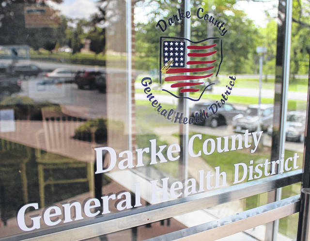 Dr. Terry Holman of the Darke County Health District is urging community members to continue taking safety precautions in light of the spike in COVID-19 cases in the county.
