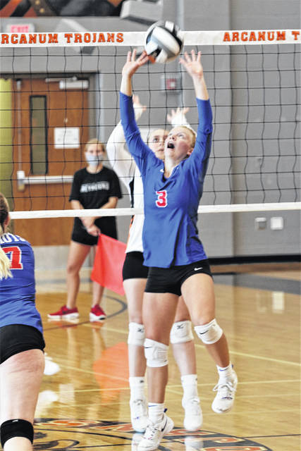 Lucie Morris makes a set for Tri-Village in the Lady Patriots win over Arcanum.
