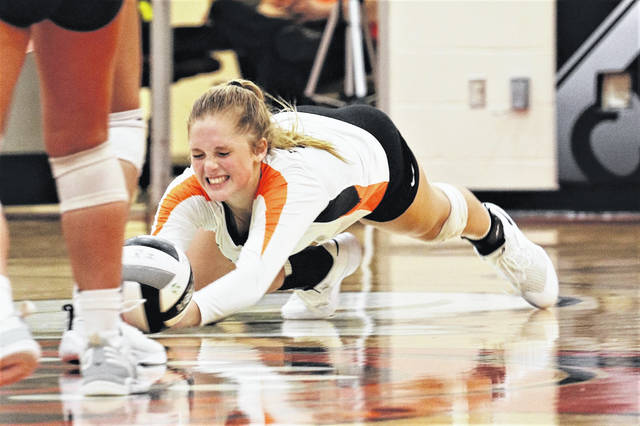 Taylor Gray goes for a dig in the Lady Trojans CCC win over the Bradford Lady Railroaders.