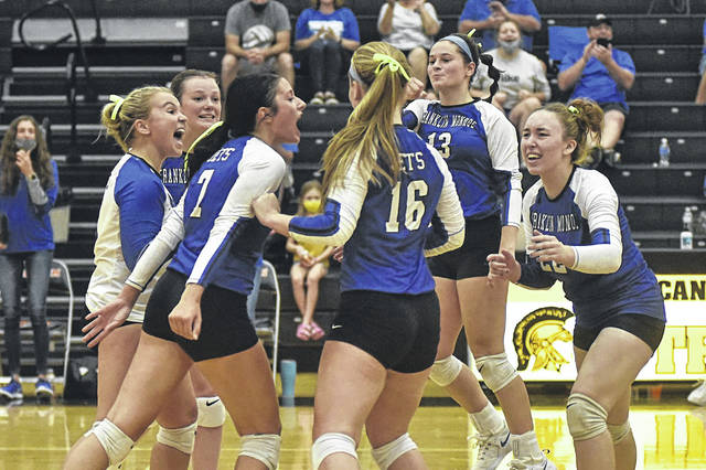 The Franklin Monroe Lady Jets celebrate their five set win over the Arcanum Lady Trojans volleyball team.