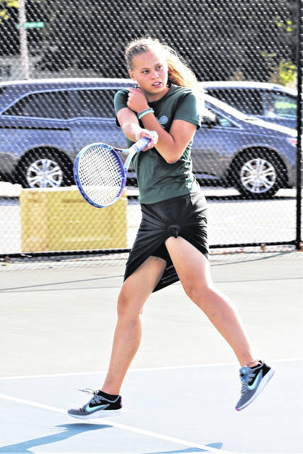 Felicity Lance places first in third singles for Greenville in the Lady Wave's MVL win over Xenia.